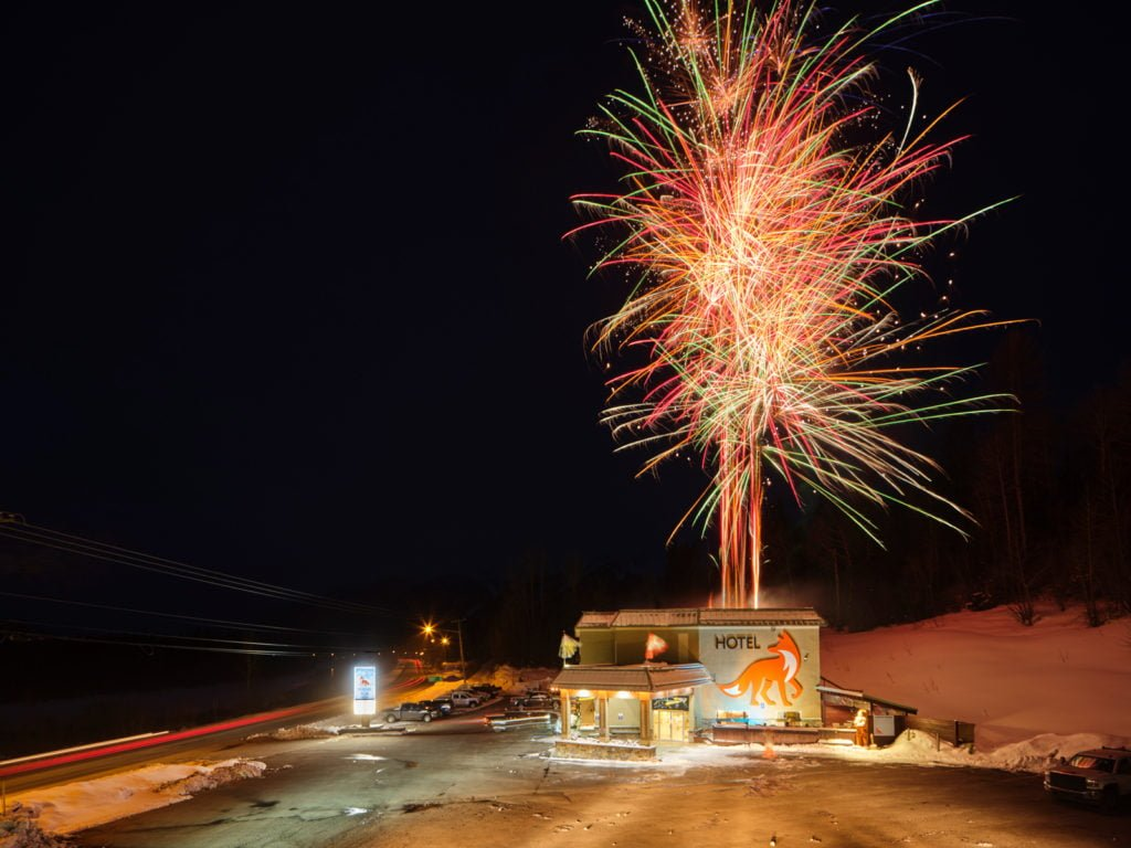 Fireworks being shot off the roof of the Fernie Fox Hotel to celebrate the hotel's rebrand as an accommodation provider in Fernie BC