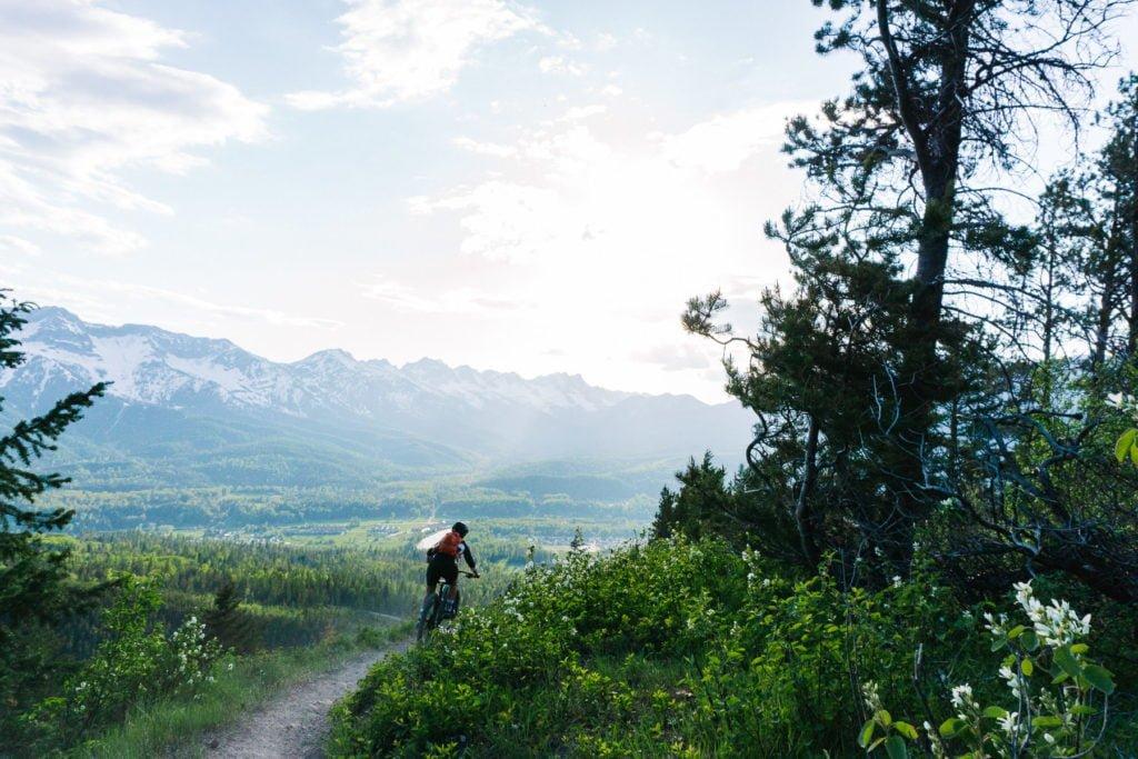 mountain biking in Fernie down a trail with view of Lizard Range near Fernie BC_photo by Kyle Hamilton